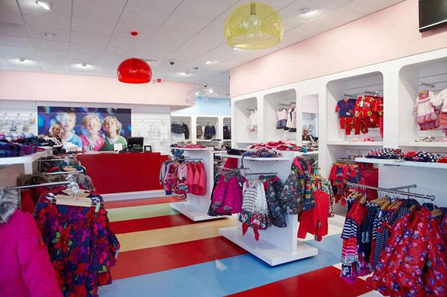 Onetech nhà phân phối giá kệ trưng bày quần áo trẻ em